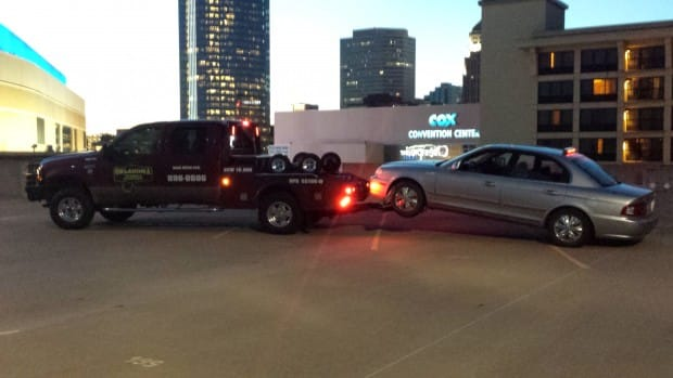 Towing from the roof of a downtown parking garage